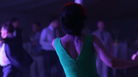 weddings : people dancing in a dark banquet hall for a wedding reception. Stock Footage