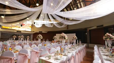 reception : Interior of a wedding hall decoration ready for guests.Beautiful room for ceremonies and weddings.Wedding concept.Luxury stylish wedding reception purple decorations expensive hall Stock Footage