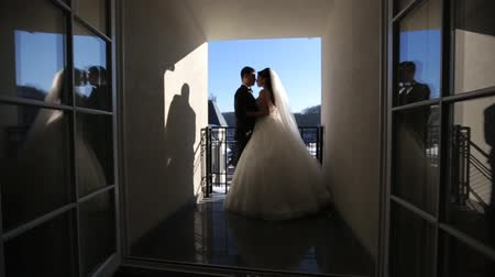 cerimônia : Bride on the terrace waits the groom. Bride standing on the balcony. Vídeos