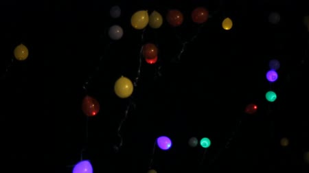 desistir : balloons rise into the dark sky