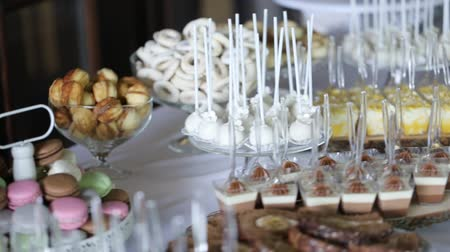 preserved cherries : Cupcakes with cream and macaroon cookies on a beautiful sweets table Stock Footage