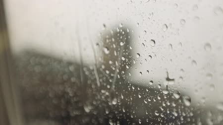 okno : Rain running down window close up