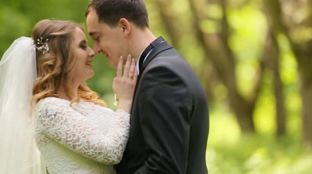 redhead suit : bride and groom embracing on a background of the forest Stock Footage
