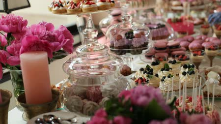 delicioso : Wedding stylish colorful candy bar in the restaurant. Close up. Dolly shot.