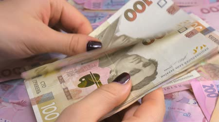 filigran : Businessmans hands counting money hryvnia. Counting Ukrainian money.
