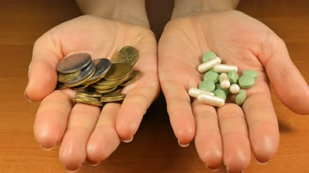 dispensary : Women with Money and Pills in Hands Offering You Choose for Health Stock Footage