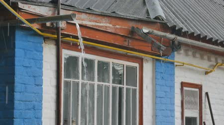 clogged : Rain falling on old house fills up house gutters