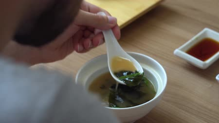kombu : The beard man stirs and eats miso soup