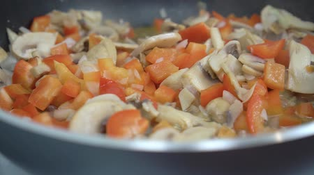garnishing : Vegetables are fried in oil in a hot pan close-up