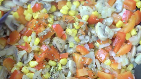 garnishing : Close-up of vegetables are fried in a pan and stirred with a spatula