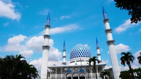 tv tower : Timelapse of The beautiful Sultan Salahuddin Abdul Aziz Shah Mosque (The Blue Mosque) , Shah Alam Selangor, Malaysia