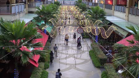 travel theme : People walking on the walkway under the christmas theme light decoration at curve shopping mall
