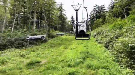 chairlift : Taken from the lift of Mountain Kurodake. It is located in the northern part of the Daisetsuzan National Park. Time Lapse Stock Footage