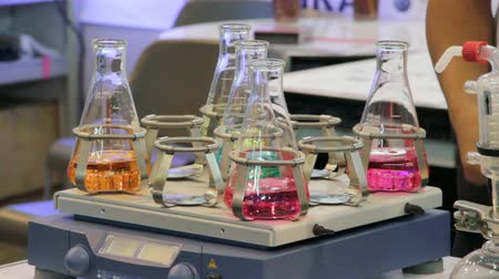 chemistry : orbital shakers with colorful liquid in lab