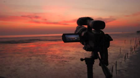 broadcast video : Video camera shooting twilight sky nature light background Stock Footage