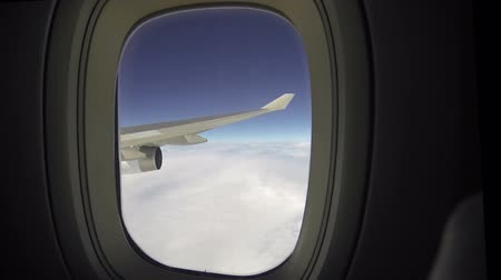 szárny : Airplane wing and sky view from window seat Stock mozgókép