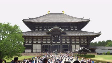 largest city : Nara, Japan - May 28, 2018 : Tourists on the way to the Main Hall of Todaiji Great Eastern Temple in daytime at Nara Kansai region Japan, zoom out shot.