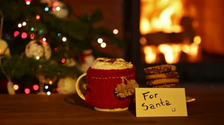Cookies and hot chocolate prepared for santa - in front of fireplace and christmas tree, cinemagraph