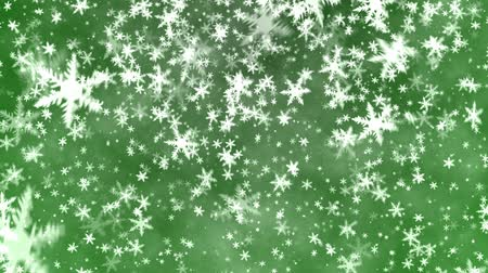 sniezynka : Snowflakes on a green background. A New Years background.