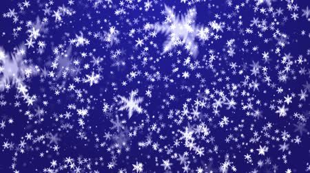 sniezynka : Snowflakes on a dark blue background. A New Years background.