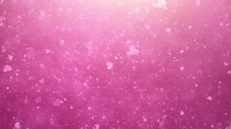 pink : Flying hearts and particles on a pink background Stock Footage