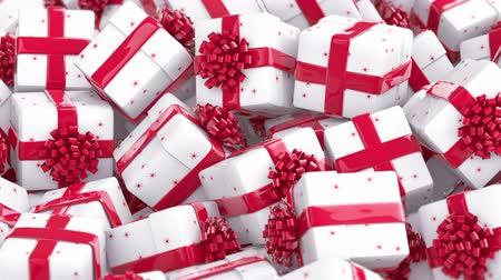 White Christmas gift boxes with red bows and ribbons