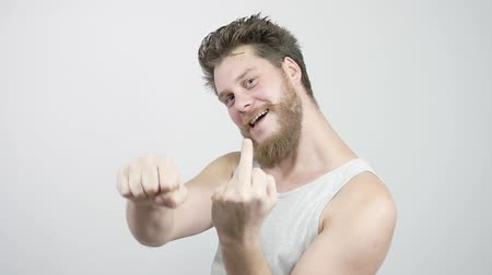irritáció : Young bearded man showing middle finger gesturing fuck.