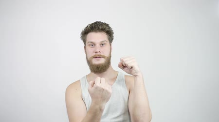 transação : Bearded guy shows his middle finger at the camera and smiling
