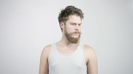 be sad : Bearded guy feels an unpleasant odor, which can be detected in his armpits Stock Footage