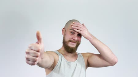 good looking guy : Caucasian Guy Shows Sign Of Like.A bearded man with a bald head smiling.