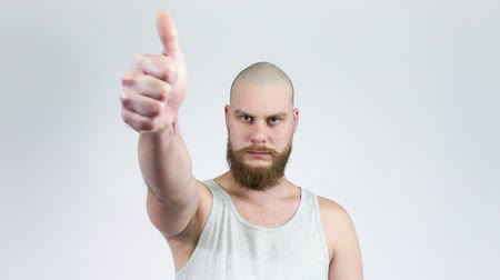teljesen : Male shows like and dislike. Bald man with beard showing thumbs up and down.