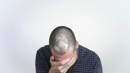 hair growth : A man with a receding hairline holding a comb and upset. Baldness disease.