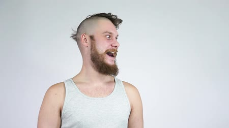 barber hair cut : Crazy man with half shaved hair laughing at the camera. Before after haircut.