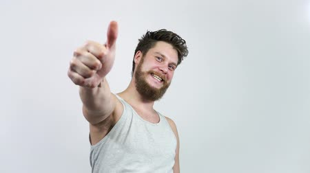 Positive Smiling Man With Thumb Up. The guy puts like.Different options.