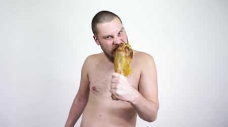 primitív : Primitive man dancing with fried chicken leg. Neanderthal, crazy, mad, monkey.