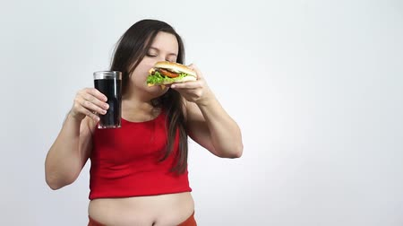 Portrait of fat woman rejects high calorie food while closed her mouth.Diet. Stock mozgókép