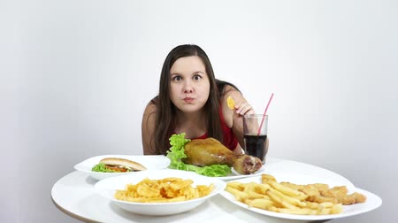 The girl on the diet took off and eats fast food.Eating, gluttony.