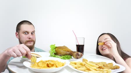 fries : Look out from under the table and steal food. Funny about junk food. Stock Footage