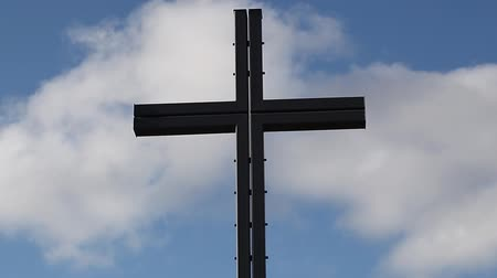 religioso : Cross on a blue sky background with clouds