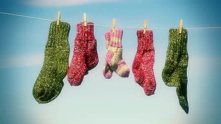 sock : Three pairs of woolen socks hanging on rope