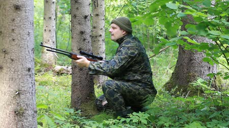 biztonság : Man with optical rifle and binoculars in the woods episode 1