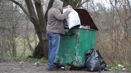 сбор : Men near crowded waste containers episode 2