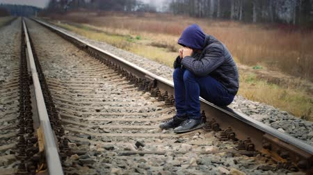 be sad : Sorrowful boy on the railway