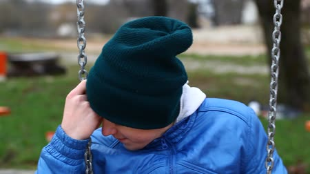 lonely : Sorrowful teenage boy swinging in the park episode 2