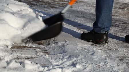 deep snow : Man with a snow shovel on the sidewalk episode 1