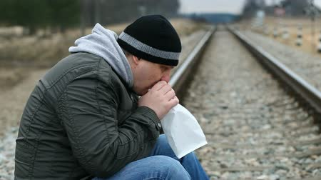 be sad :  Worried man breathe into a paper bag on a railway episode 1