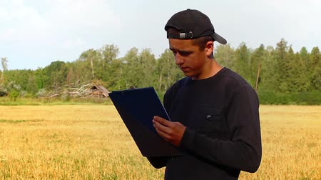 dobrador : Teen with folder on the field near forest