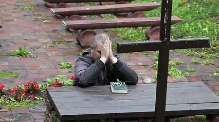 christian : Man prays kneeling at the altar Stock Footage