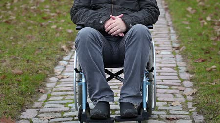 medicals : Disabled man sitting on wheelchair at outdoor