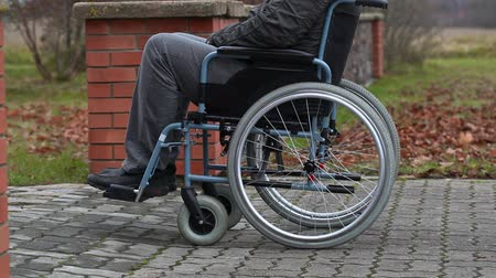 medicals : Disabled man in wheelchair on sidewalk Stock Footage